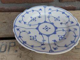 Blauw saks ontbijtborden geschulpt